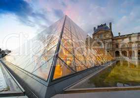 PARIS - JUNE 15 : Louvre museum at twilight in summer on June 15