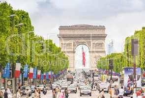 PARIS - JULY 20, 2014: Tourists walk along Champs Elysees in Par