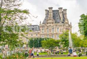PARIS - JULY 20, 2014: Tourists walk along Tuileries Gardens in