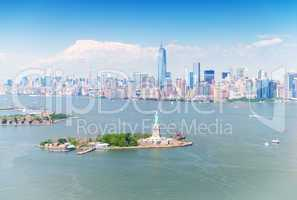 Stunning Manhattan aerial panorama with Statue of Liberty on for