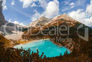 Stunning azure color of mountain lake surrounded by vegetation a