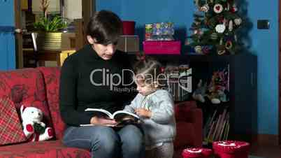 Mom Reading Book To Child During Xmas Holidays At Home