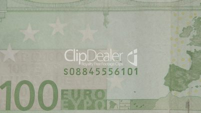 Lower left details of the green 100 Euro bill