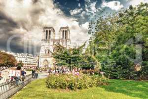 PARIS - MAY 21, 2014: Tourists at Notre Dame Cathedral. More tha