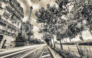 PARIS - MAY 21, 2014: Illuminated Eiffel Tower at dusk. The Eiff