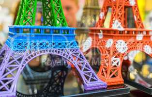 PARIS - JULY 20, 2014: Colourful miniatures of Eiffel Towers. Th