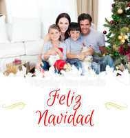 Composite image of happy family at christmas time holding lots o