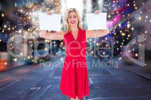 Composite image of stylish blonde in red dress holding pages