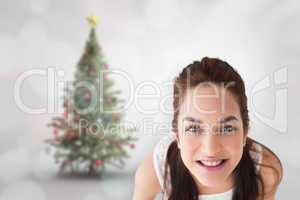 Composite image of happy brunette holding present with shoes