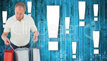 Composite image of man looking in shopping bags