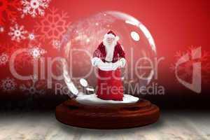 Santa holding open sack snow globe