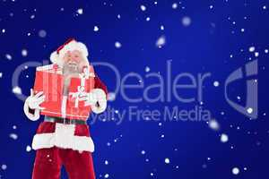 Composite image of santa carries a few presents