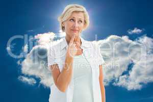 Composite image of mature woman thinking with hand on chin
