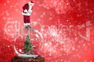 Composite image of santa standing on snow globe