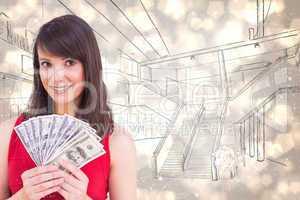 Composite image of brunette showing fan of dollars