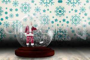 Santa presenting in a snow globe