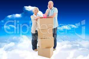 Composite image of older couple smiling at camera with moving bo