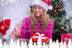 Composite image of sitting couple giving each other presents