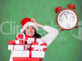 Composite image of shocked woman with christmas presents