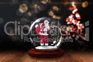 Santa asking for quiet in snow globe