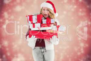 Composite image of blonde woman in trouble holding pile of gifts