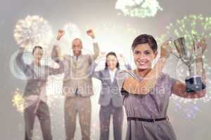 Composite image of woman holding up a cup with enthusiastic cowo