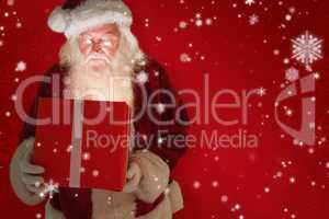 Composite image of father christmas opening a magical christmas
