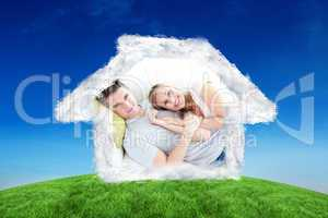 Composite image of caress young couple lying together on the sof
