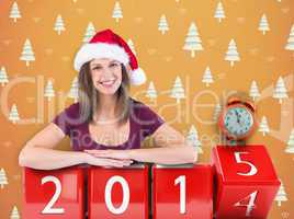 Composite image of festive brunette leaning on large poster
