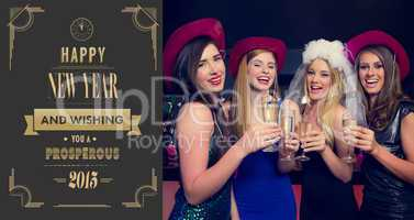 Composite image of laughing friends clinking champagne glasses a