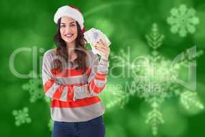 Composite image of festive brunette holding her cash