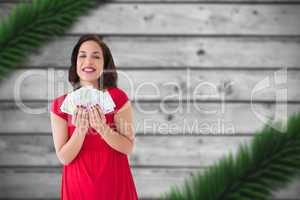 Composite image of stylish brunette in red dress holding cash