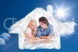 Composite image of smiling couple getting ready to move in a new