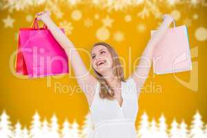 Composite image of blonde woman raising shopping bags