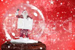 Santa ringing bell and holding sign in snow globe