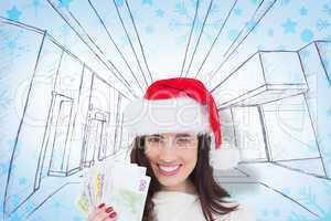Composite image of happy brunette holding her cash