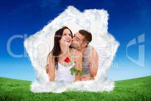 Composite image of lovers sitting on bed with a rose