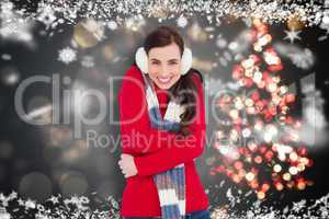 Composite image of happy brunette in winter clothes smiling at c