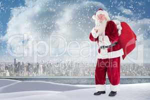 Composite image of santa standing on snowy ledge
