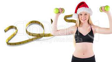 Composite image of festive fit blonde smiling at camera