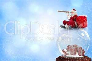 Composite image of santa sitting on snow globe