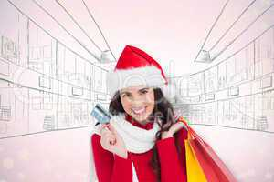 Composite image of excited brunette holding shopping bags and cr