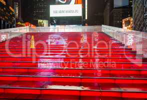 NEW YORK CITY - MAY 27: Wet red stairs of Duffy Square in Times