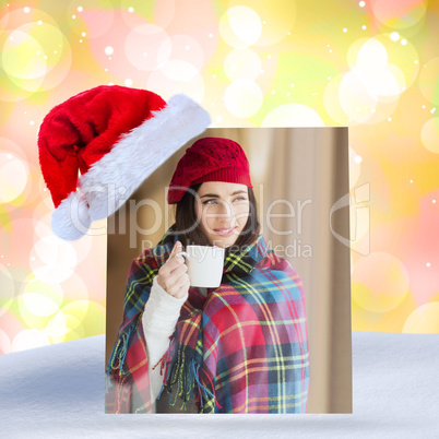 Composite image of brunette with cover holding mug and thinking