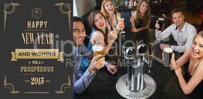 Composite image of laughing friends raising their glasses up