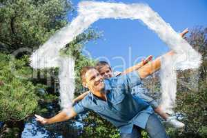 Composite image of son playing with his dad outside