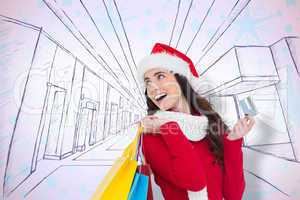 Composite image of festive brunette holding shopping bags and cr