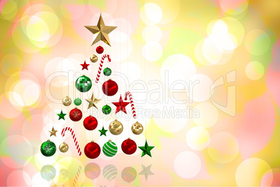 Composite image of christmas tree shape of baubles