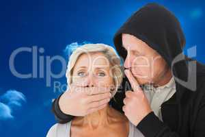 Composite image of older man silencing his fearful partner