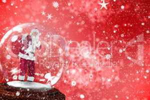 Composite image of santa asking for quiet in snow globe